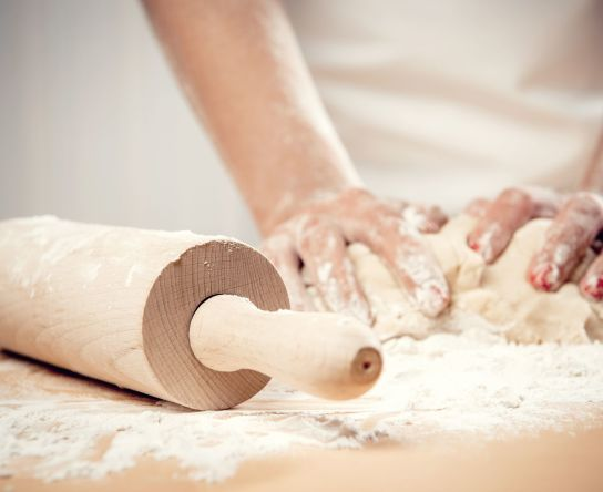 19760306 - woman kneading dough, close-up photo